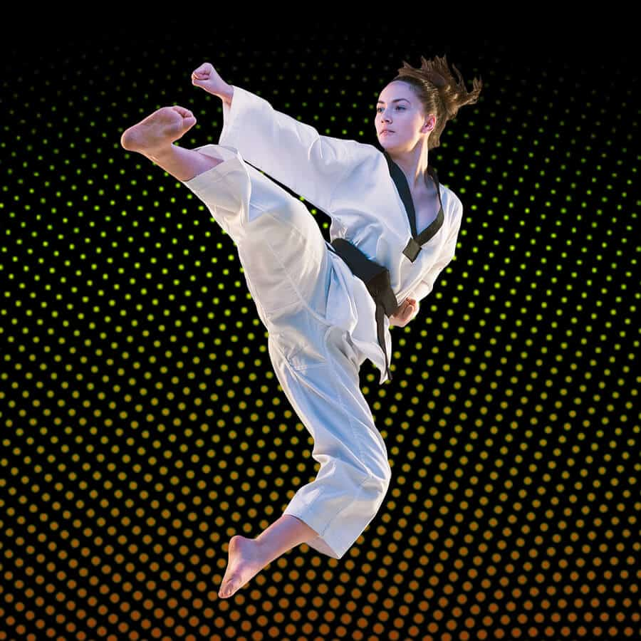 Martial Arts Lessons for Adults in Vista CA - Girl Black Belt Jumping High Kick