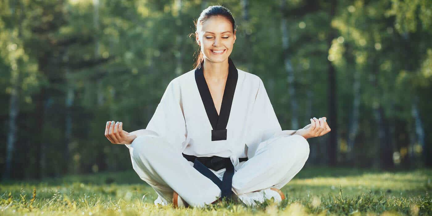 Martial Arts Lessons for Adults in Vista CA - Happy Woman Meditated Sitting Background